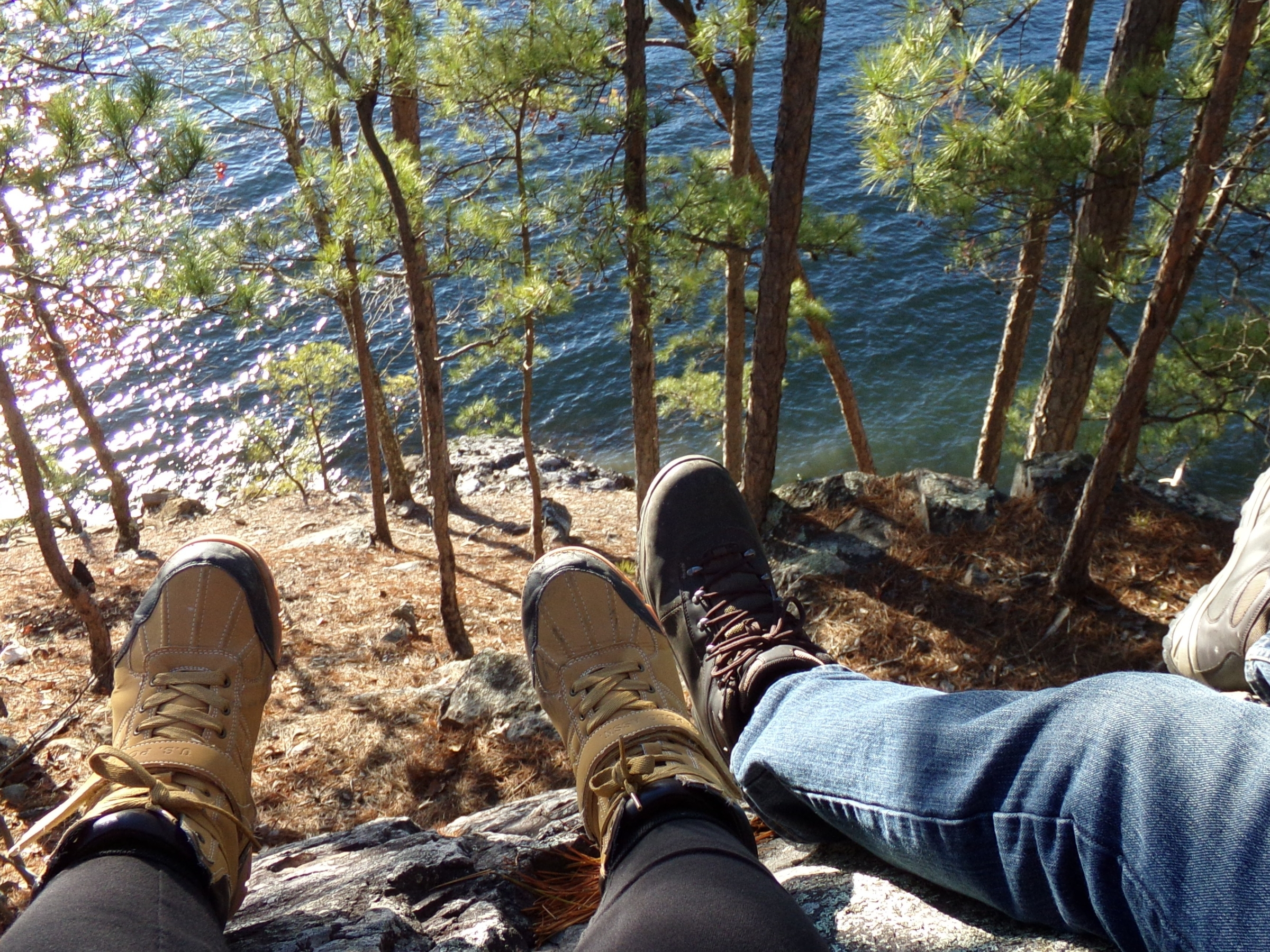 Feet dangling from a rock