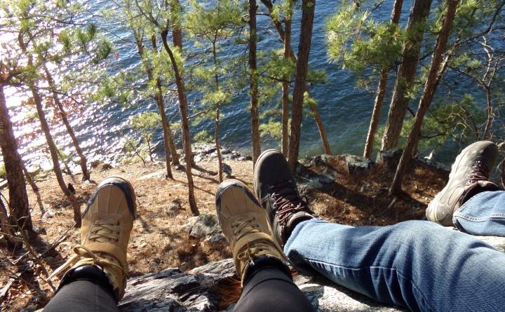 Feet dangling from a rock