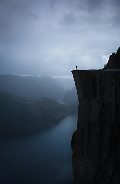 Man standing on edge of cliff.