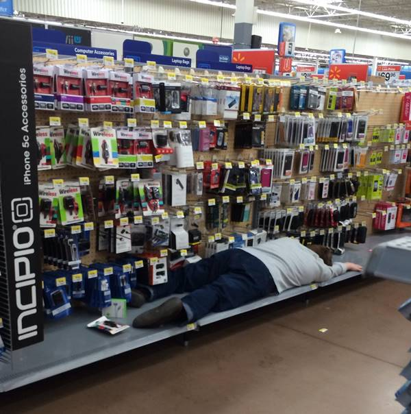 Man sleeping on walmart shelf. https://thewondrous.com/wp-content/uploads/2015/04/strange-people-at-walmart.jpg